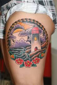 traditional flowers and lighthouse on side thigh