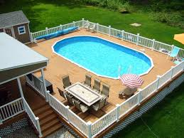 yards with above ground pools fence and furniture above ground