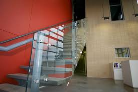perfect spiral glass staircase with chrome metal frame as well as