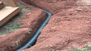 wet yard air conditioner drip fixed french drain with gravel