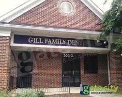gill family dentistry brands with dimensional letter building sign