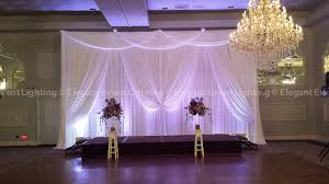 wedding event backdrop white wedding fabric backdrop purple uplighting drury