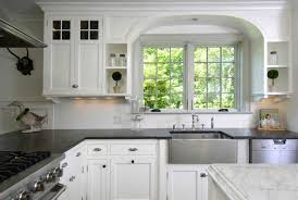 classic black white kitchen design with pendant lamps and white