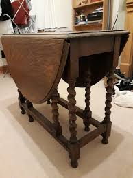 dark wood drop leaf table large dark wooden drop leaf table used sturdy no defects at all