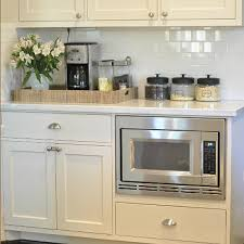 Ivory Colored Kitchen Cabinets - ivory kitchen cabinets with gray backsplash design ideas