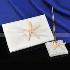 ivory themed guest book and pen set with sea and seashell
