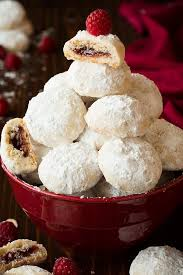 raspberry almond snowball cookies jam stuffed snowballs recipe