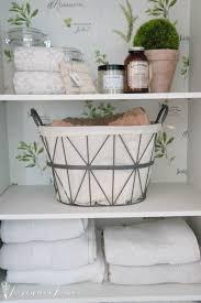 adding wallpaper to the linen cabinet seeking lavendar lane