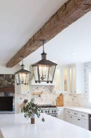 white kitchen cabinets with wood beams whitewoodflooring woodbeams ceilingideas 45 amazing