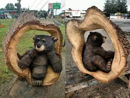 cool wood sculptures cubs chillin till they go to mesa chainsaw wood