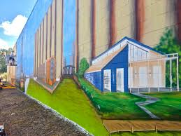 a mural comes together in the old first ward buffalo rising buffalo mural ward ny 3