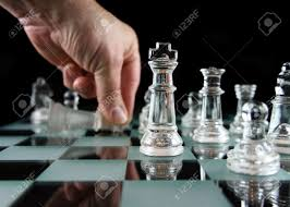 glass chess pieces on a frosted glass chess board stock photo