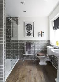 good bathroom with grey subway tiles and heated towel rail also