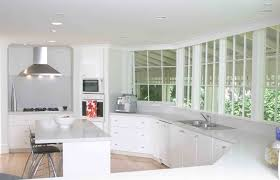 All White Kitchen Ideas Gray Solid Countertop Integral Sink Dark Wooden Bar Stools Black