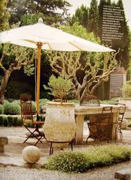 patio chair feat umbrella and table stone country french country