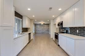 kitchen backsplash with cabinets and light countertops white shaker cabinets light countertops backsplash
