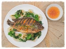 chien cuisine crispy fish ca chien with wilted greens the wooden boat