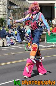 clown stilts clown on stilts photo