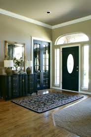 Foyer Paint Color Ideas by Dark Brown Front Door Recessed Into The Front Foyer Incorporate