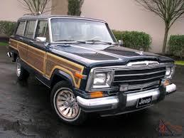jeep slammed wagoneer the original grand woody suv