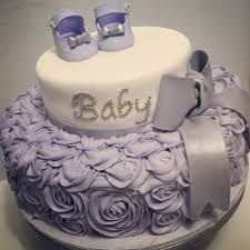 top baby shower lilac or lavender baby shower cake for girl baby shoes bow and