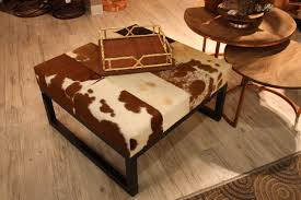 how to use a cowhide ottoman to create a cowboy chic decor