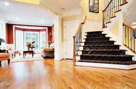 open entryway with wood floor and staircase with view of living