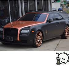 rolls royce chrome royce wrapped in avery sw satin black and arlon 2600cx copper