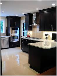 love the dark cabinets and light counter tops and floor with