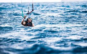 barack obama is kitesurfing with richard branson and clearly doesn