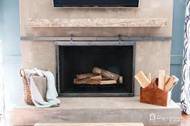 Fireplace Opening Covers by How To Make A Barn Door Style Fireplace Screen Designer Trapped