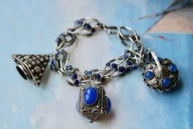 antique silver bracelet charms images Antique silver charm bracelet set with blue gems and various jpg