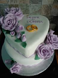 first ever wedding cake i done bottom cake is fruit cake and top