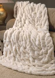 decorating white faux sheepskin rug plus brown sofa and cushions