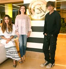 in pics shah rukh abram and gauri khan have a special guest
