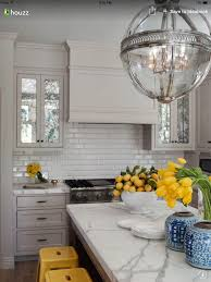 white beveled subway tiles light grey cabinets marble countertop