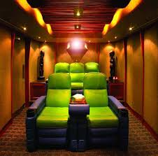 small home theater room with statues and green purple home theater