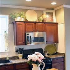 decorating ideas above kitchen cabinets decorating above kitchen cabinets ideas decorating ideas above