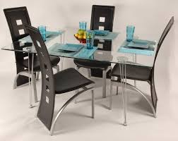 simple frosted glass dining table with blue vase and black leather