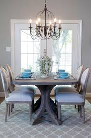 148 best dining images on pinterest chip and joanna gaines the dining room is illuminated with a dark metal chandelier and staged with bright comfortable