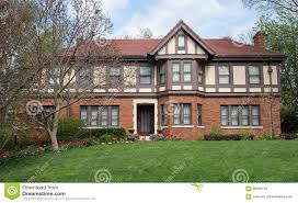 english tudor home with red spring tulips stock photo image