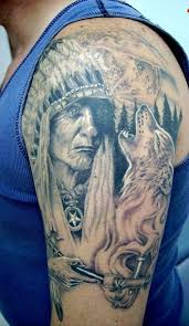 old american native warrior and a wolf tattoo on half