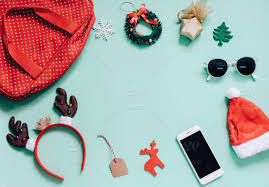 christmas accessories concept flat lay of christmas ornaments and woman bag