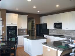 Black Kitchen Appliances by Kitchen Style Black Dining Table Chairs Light Hardwood Floors