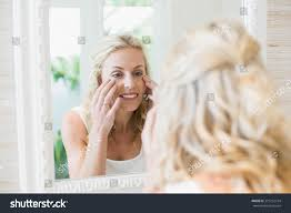 Mirror In The Bathroom by Beautiful Woman Looking Herself Mirror Bathroom Stock Photo