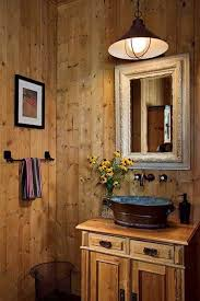 barn rustic bathroom with vessel sink and wall mounted faucet
