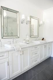 best ideas about dark floor bathroom pinterest white bath height desk boasting mint green cabinets adorned with brass hardware paired sleek black stool kartell masters alongside white and blue