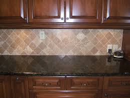 black granite kitchen counter tops with diagonal cream stone tile