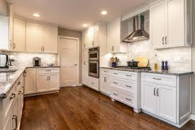 how to paint stained kitchen cabinets staining and painting kitchen cabinets reliable home