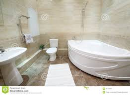 light and clean bathroom with toilet with tiles on floor royalty